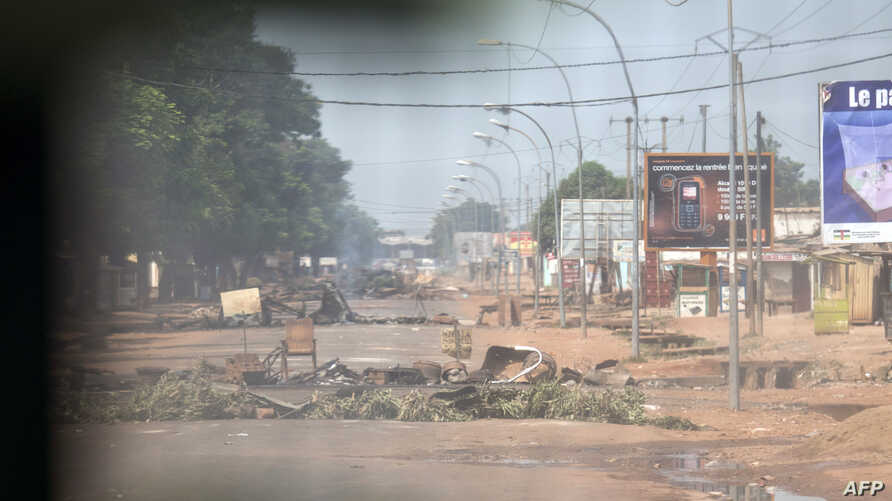 From inside a light armoured vehicle shows street barricades set up by anti-Balaka forces in Bangui's Combattant neighbourhood, Central African Republic, Feb. 19, 2014.