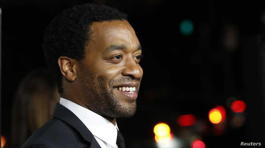 """Cast member Chiwetel Ejiofor poses at a special screening of """"12 Years a Slave"""" at the Directors Guild of America, Los Angeles, Oct. 14, 2013."""
