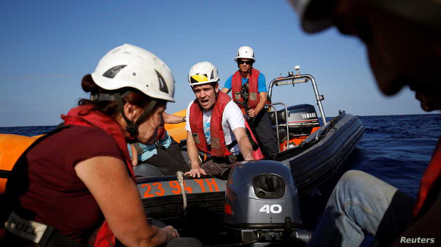 Aid workers from the aid group Sea-Watch carry out training drills off the coast of Malta in preparation for a mission in the Mediterranean to search for migrants attempting to reach Europe by boat from the Libyan coast, Nov. 2, 2016.