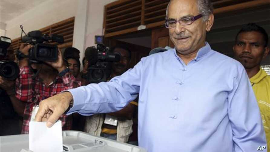 East Timor President Jose Ramos-Horta casts his ballot during the presidential election in Dili, East Timor, Saturday, March 17, 2012.
