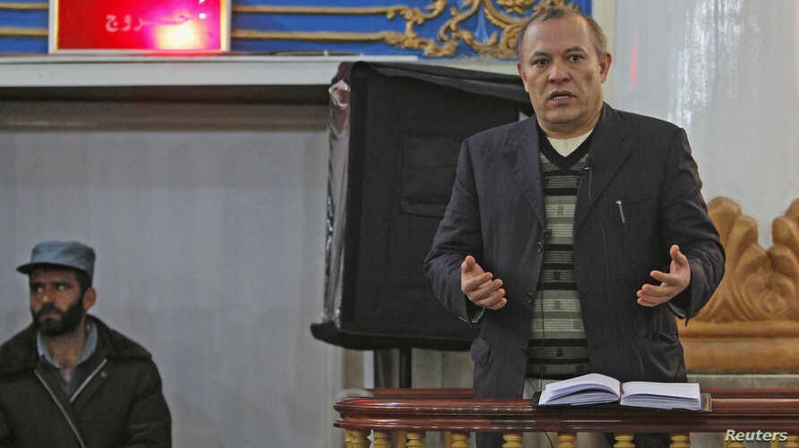 Sherkan Farnood, founder of Kabulbank, speaks in court in Kabul, March 5, 2013.