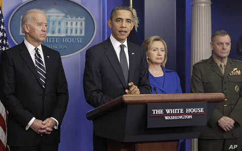 President Obama discusses the yearly report on progress in Afghanistan. He was joined by Vice President Joe Biden, left, Secretary of State Hillary Clinton and Joint Chiefs Vice Chairman Marine General James Cartwright