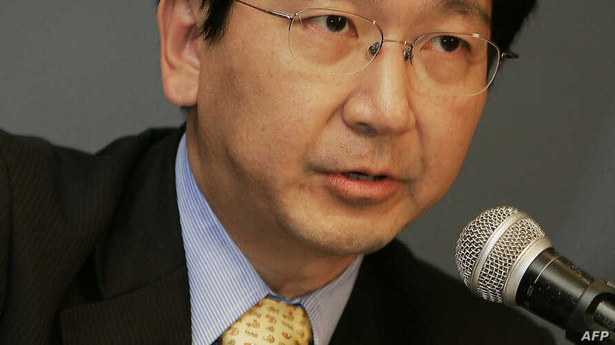 FILE - Professor Johannes M. Chan addresses the media during a press conference