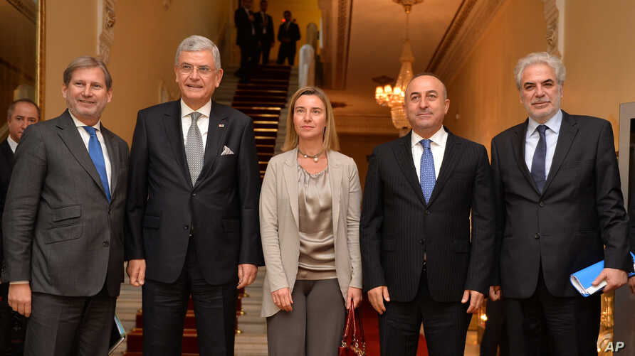 From left, European Union official Johannes Hahn, Turkey's EU Affairs Minister Volkan Bozkir, EU Foreign Afffairs and Security Policy Vice President of the Commission Federica Mogherini, Turkish Foreign Minister Mevlut Cavusoglu and EU official Chris