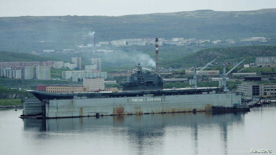 FILE - Russian aircraft carrier Admiral Kuznetsov is seen at a shipyard in the town of Roslyakovo, near Murmansk, Russia, June 19, 2006.