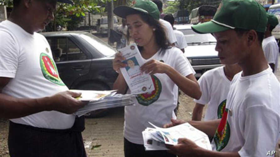 Members of Union Solidarity and Development Party (USDP) gather on a road as they distribute party's pamphlets for Nov. 7 general elections to locals during the party's campaign in Rangoon, Burma, 09 Oct 2010
