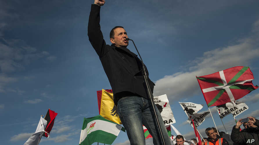 Arnaldo Otegi, leader of the former Basque independence Batasuna party, addresses a crowd as he leaves Logrono prison in Logrono, northern Spain, March 1,2016.