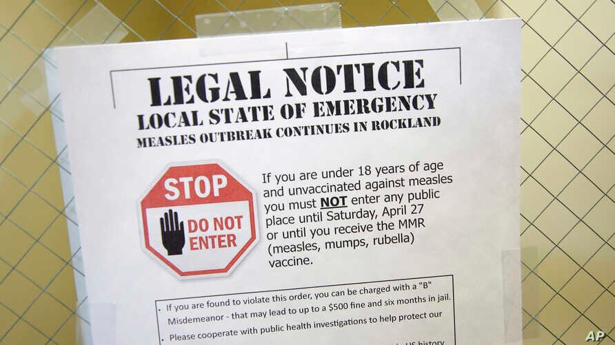A sign explaining the local state of emergency because of a measles outbreak at the Rockland County Health Department in Pomona, N.Y., March 27, 2019.