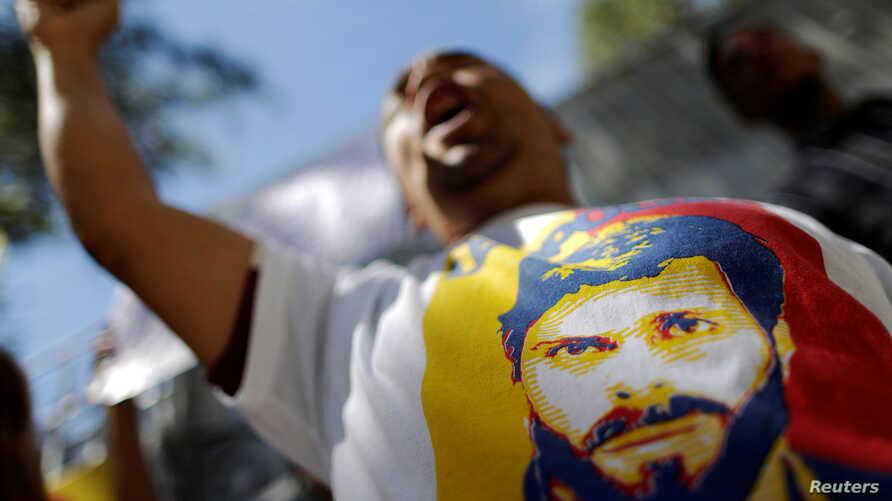 A supporter of jailed opposition leader Leopoldo Lopez shouts slogans Dec. 6, 2016, during a protest calling for the government of Venezuela's President Nicolas Maduro to order the release of political prisoners. On Tuesday, Dec. 13, 2016, four oppon