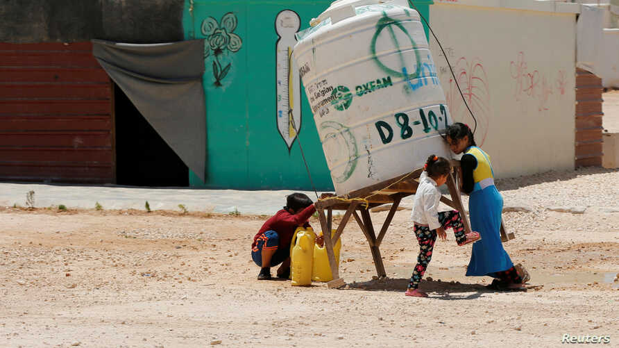 Syrian refugees children collect water at the Al-Zaatari refugee camp in Mafraq, Jordan, near the border with Syria May 30, 2016.