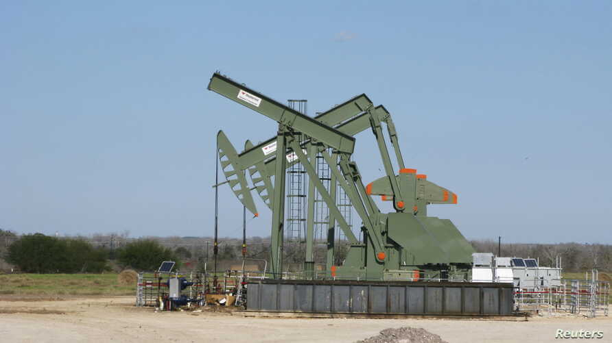 A pump jack stands idle in Dewitt County, Texas, Jan. 13, 2016.