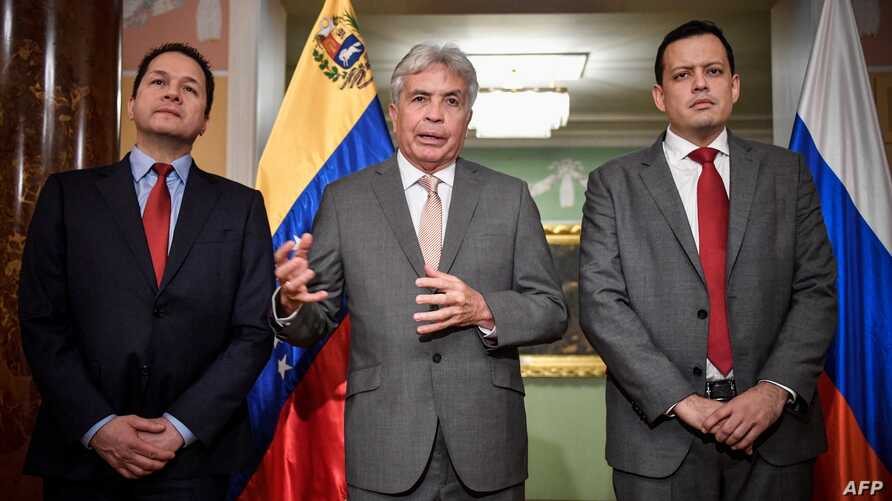 Venezuelan Ambassador to Russia Carlos Rafael Faria Tortosa (from left), Venezuela's minister of agriculture Wilmar Castro Soteldo and finance minister Simon Zerpa give a press briefing in Moscow after Venezuela signed a debt restructuring deal with