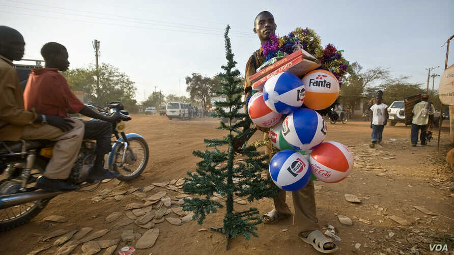 Street vendor in Juba, South Sudan, selling plastic Christmas trees and inflatable balls made in China. Training can help street vendors improve their business skills, their income and their chances of finding alternative work.(Photo: UNESCO/Sven Tor