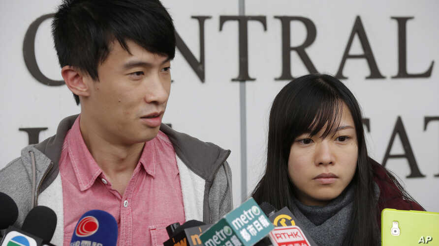 Pro-democracy lawmakers Sixtus Leung, left, and Yau Wai-ching speak to the media outside a police station after being released on bail in Hong Kong, April 26, 2017.