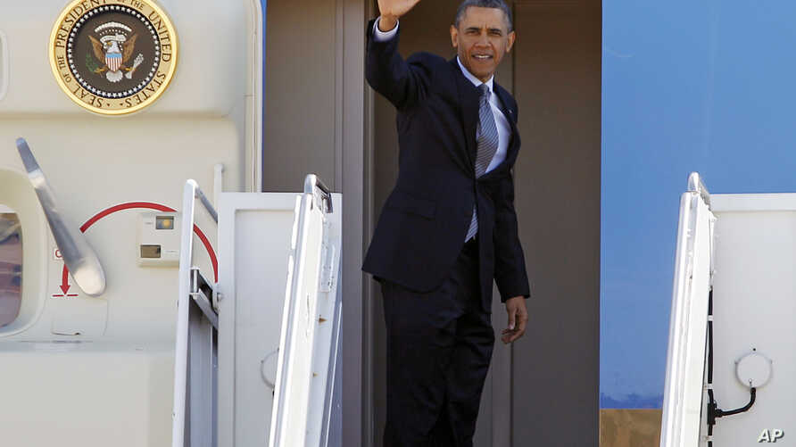 President Barack Obama waves prior to boarding Air Force One before departing form Andrews Air Force Base, in Md., March. 15,  2013.