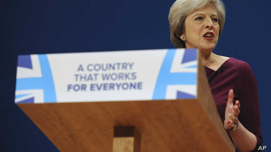 British Conservative Party Leader and Prime Minister Theresa May addresses delegates at the Conservative Party Conference at the ICC, in Birmingham, England, Oct. 5, 2016. May's government alarmed liberals by saying that businesses should prioritize