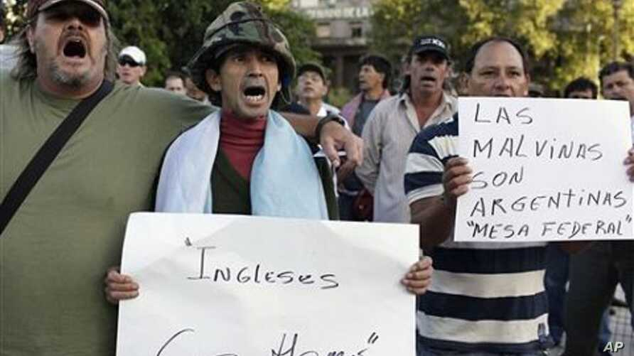 Falklands war veterans, one holding up a sign that reads in Spanish 'The islands are Argentine,' referring to the Falklands islands, demonstrate in front of the National Congress in Buenos Aires (File Photo)