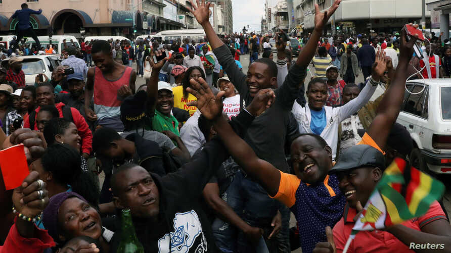Protesters calling for Zimbabwean President Robert Mugabe to step down take to the streets in Harare, Zimbabwe, Nov. 18, 2017.