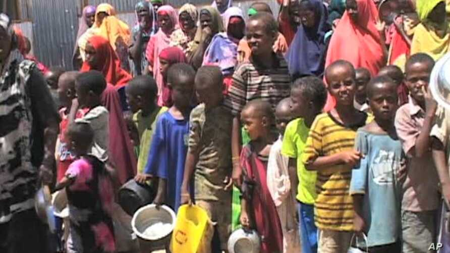 Twice a day, crowds of hungry people line up outside feeding centers all across Mogadishu, holding a pan or a bucket to receive a hot meal