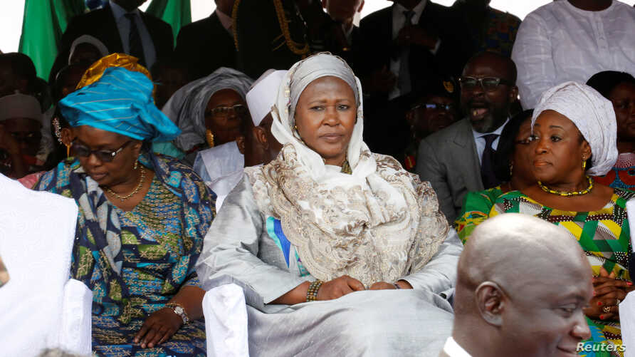 FILE - Gambia new Vice President Fatoumata Jallow Tambajang (center), is seen during President Adama Barrow's swearing-in ceremony and the Gambia's Independence day ceremony at Independence Stadium, in Bakau, Gambia, Feb. 18, 2017.