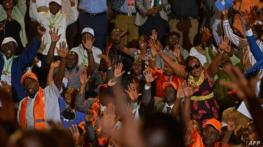 FILE - Opposition supporters react on Jan. 11, 2017 in the capital Nairobi, where leaders  from at least 15 main opposition parties gathered to announce their new formed alliance against the President Uhuru Kenyatta and his deputy, William Ruto's-led