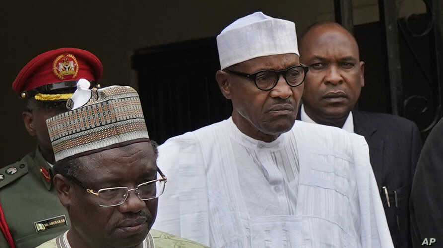 Incumbent President Muhammadu Buhari, center, leaves his party's headquarters after holding an emergency meeting with senior members of the All Progressives Congress (APC) in Abuja, Nigeria, Feb. 18, 2019.