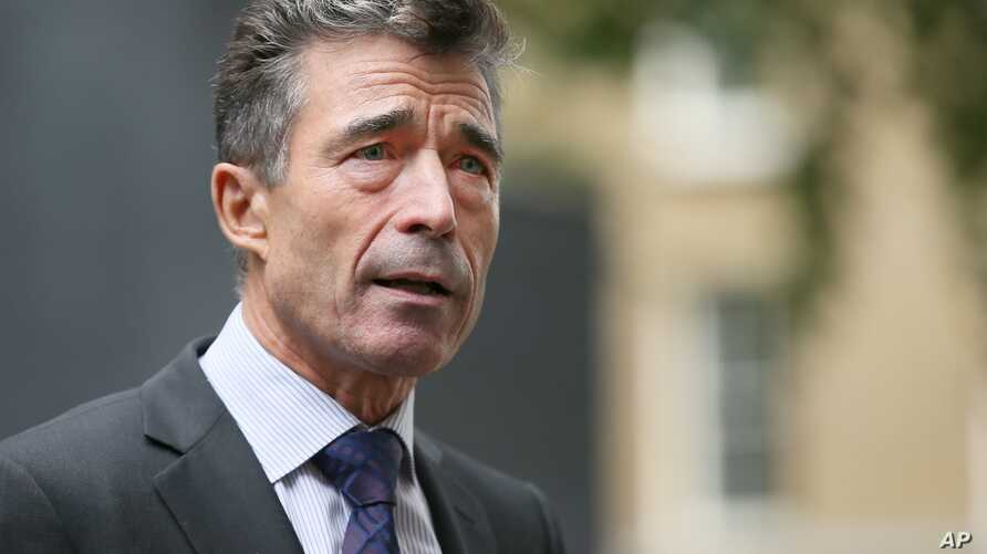 NATO Secretary General Anders Fogh Rasmussen speaks to the media after a meeting with Britain's Prime Minister David Cameron at 10 Downing Street in London, Sept. 18, 2013.