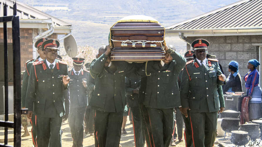 The coffin of Lesotho's Army Lieutenant General Khoantle Motsomotso is carried at his funeral in Malibamatso, Sept. 14, 2017.