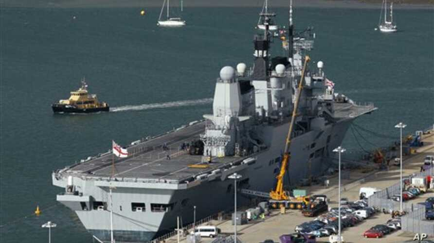 British aircraft carrier HMS Ark Royal lies alongside a quay at the navy dockyard in Portsmouth, England, 19 Oct 2010