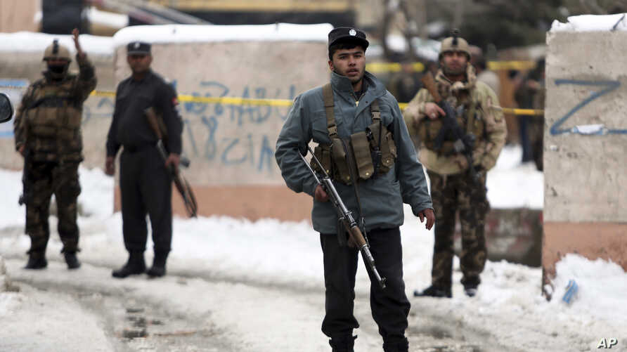 Security personnel stand guard at the site of a suicide attack on the Supreme Court in Kabul, Afghanistan, Feb. 7, 2017.