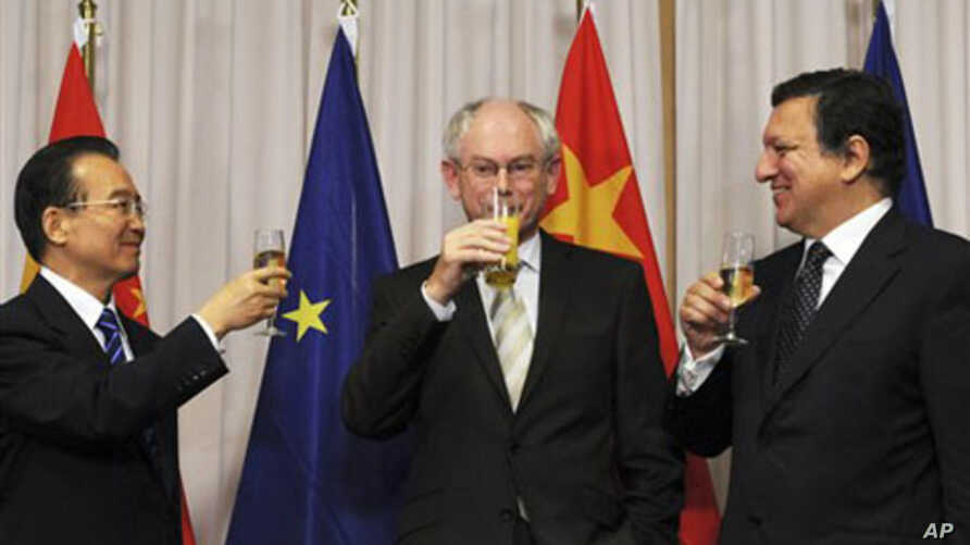 From left to right:China's Prime Minister Wen Jiabao,  European Union Council President Herman Van Rompuy, and European Union Commission President Jose Manuel Barroso are seen following the signing ceremony of two agreements between the European Unio