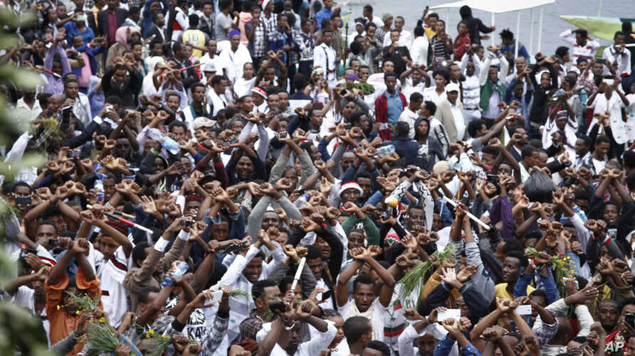 In this photo taken on Sunday, Oct. 2, 2016, Ethiopians chant slogans against the government during their march in Bishoftu. Dozens of people in the Oromia region were killed that day in a stampede when police tried to disrupt an anti-government prot