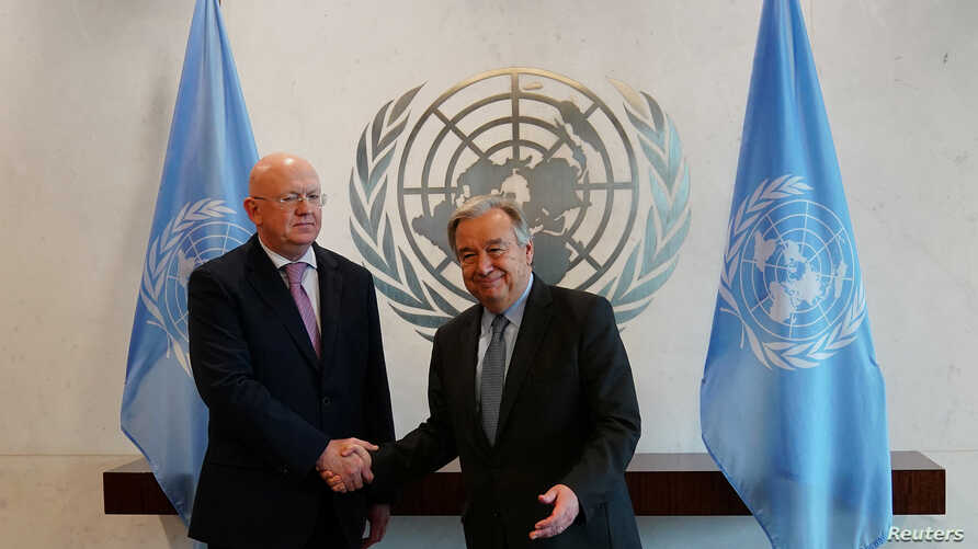 The new Russian Ambassador to the United Nations Vasily Nebenzia shakes hands after he presented his credentials to Secretary-General Antonio Guterres at U.N. Headquarters in New York City, New York, July 28, 2017.