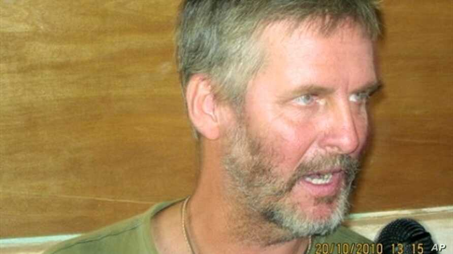 Frans Barnard, employed by the British Save the Children charity, speaks to the media after his release in Adado on October 20, 2010.