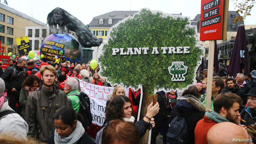 """People march during a demonstration under the banner """"Protect the climate - stop coal"""" two days before the start of the COP 23 UN Climate Change Conference hosted by Fiji but held in Bonn, Germany, Nov. 4, 2017."""
