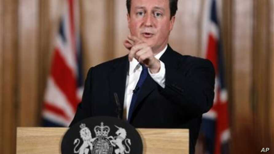 Britain's Prime Minister David Cameron gestures during a press conference in Downing Street in London, where he said aid worker Linda Norgrove, 36, who died in Afghanistan during a rescue attempt, may have been killed by her American rescuers, rather