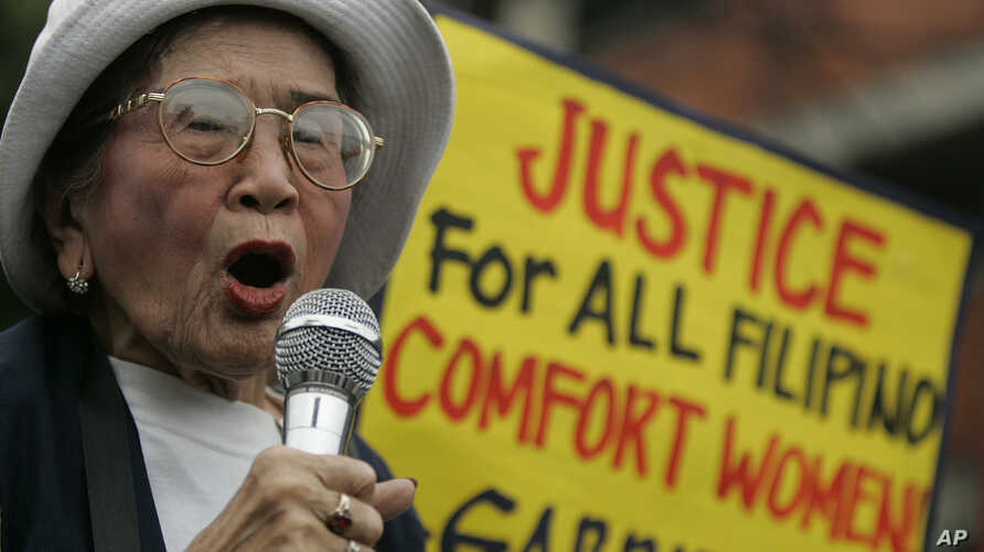 """FILE - Anastacia Cortez, 92, who says she was held as a """"comfort woman"""" by the Japanese military during World War Two, speaks  as members of the Lila Pilipina hold a rally at the Mendiola bridge, near the Malacanang Presidential palace in Manila, Phi"""