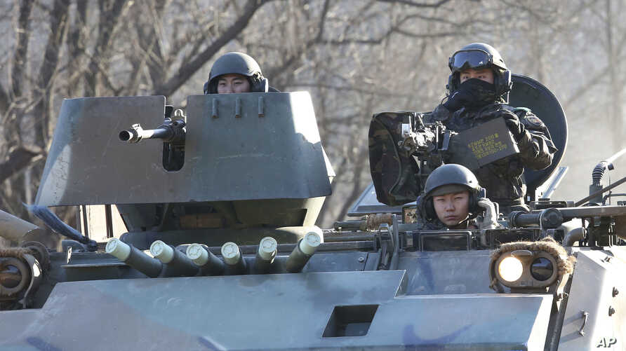 South Korean soldiers ride an armored during an annual exercise in Paju, near the border with North Korea, Dec. 2, 2016. South Korea and Japan on Friday announced their own new sanctions on North Korea.