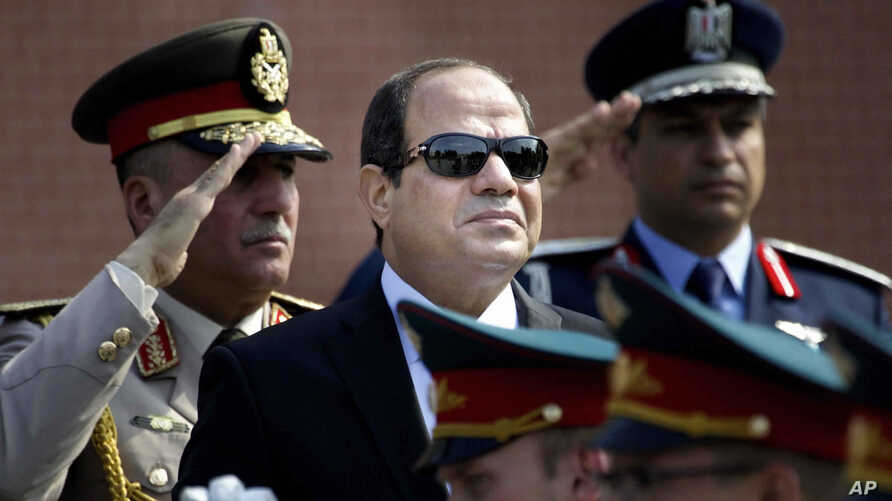 FILE - Egyptian President Abdel-Fattah el-Sissi, center, reviews honor guards, in Moscow, Russia, Aug. 26, 2015.