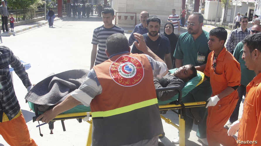 A man is brought to a hospital on a stretcher after after being wounded in a clash between Iraqi forces and Sunni Muslim protesters in Kirkuk, 250 km (155 miles) north of Baghdad, April 23, 2013.