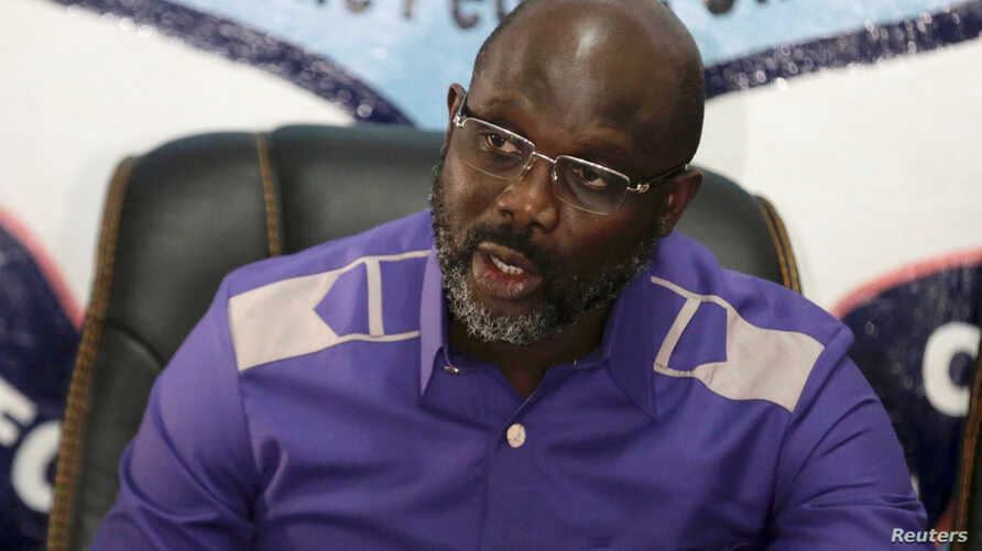 President-elect George Weah of Coalition for Democratic Change (CDC) attends a news conference at party headquarters, after the announcement of the presidential election results, in Monrovia, Liberia, Dec. 30, 2017.