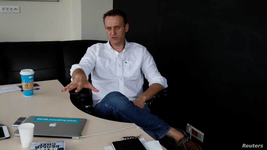 FILE - Russian opposition leader Alexei Navalny speaks during an interview, July 12, 2017, with Reuters in Moscow.