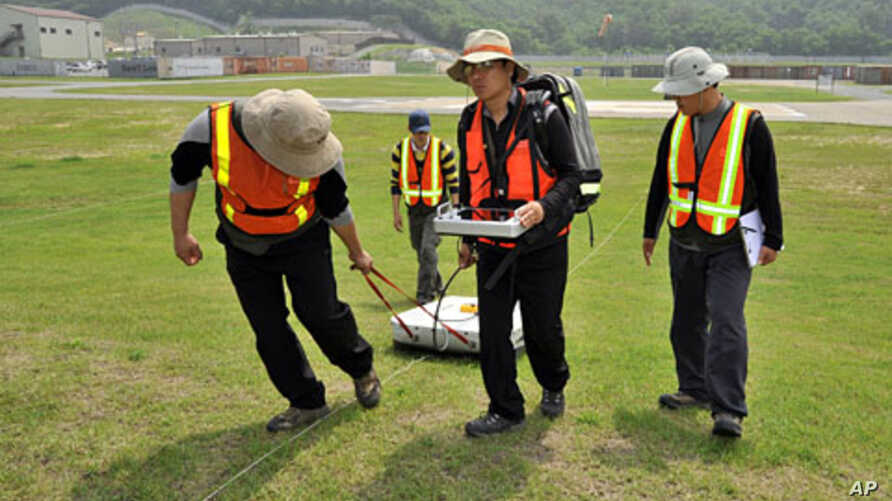 South Korean technicians conduct a ground-penetrating radar survey of alleged burial of a highly toxic defoliant at Camp Carroll, a US army logistics base, southeast of Seoul, June 2, 2011