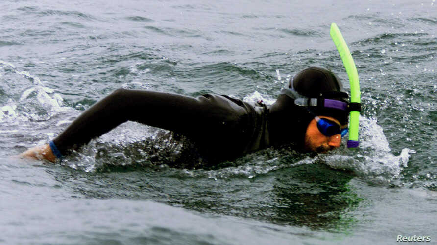 FILE - French-American swimmer Ben Lecomte is seen during his 1998 trans-Atlantic swim, off the Brittany port of Quiberon.