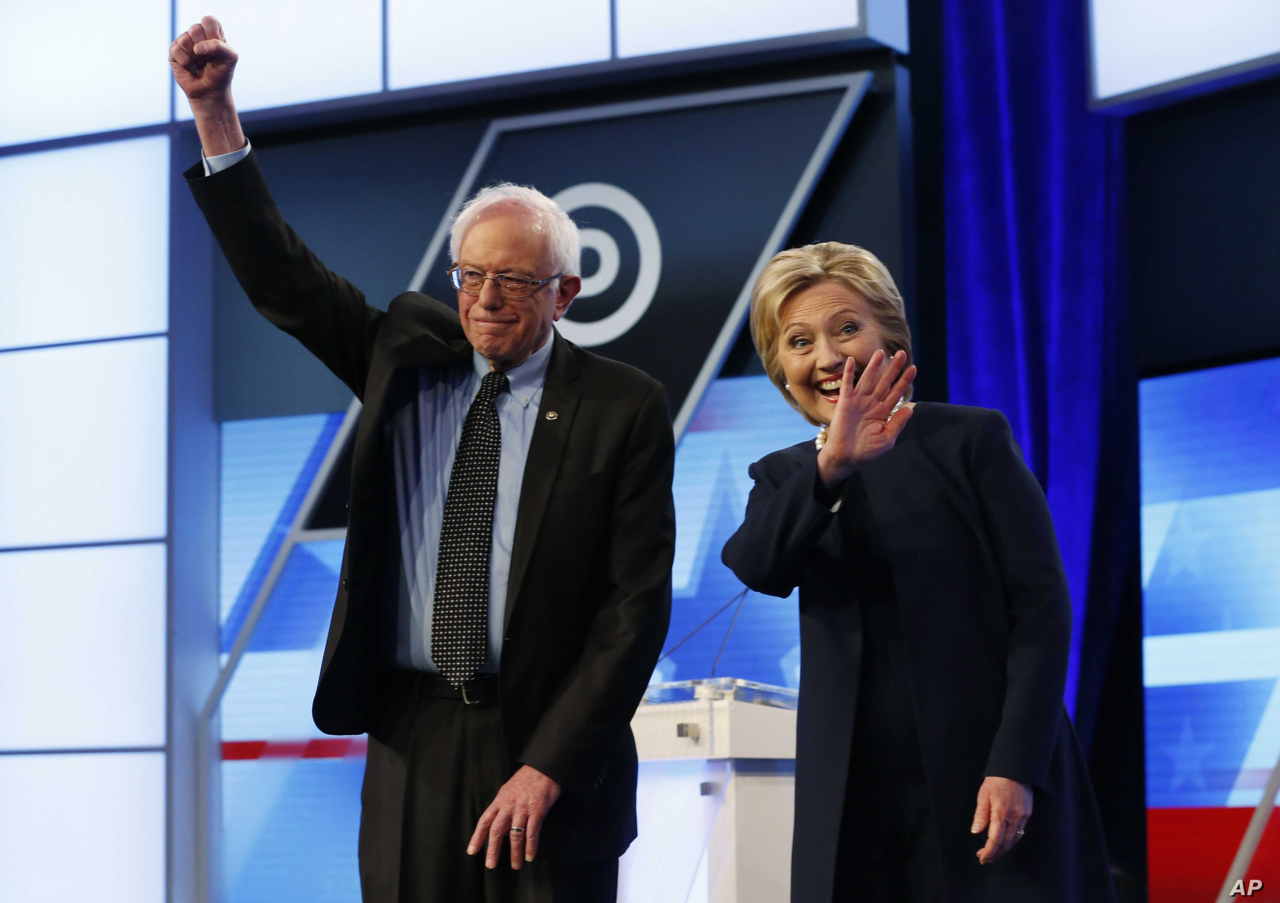 Democratic presidential candidates, Hillary Clinton and Sen. Bernie Sanders, I-Vt,  stand together before the start of the Univision, Washington Post Democratic presidential debate at Miami-Dade College in Florida, March 9, 2016.