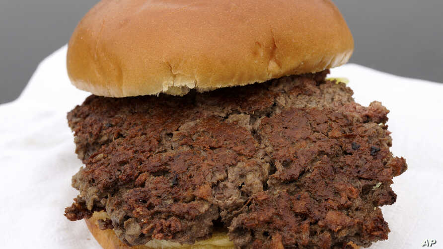 """This is the """"Impossible Burger,"""" a plant-based burger made from wheat protein, coconut oil, potato protein and other ingredients, shown in Bellevue, Neb., Jan. 11, 2019. A report released Jan. 16, 2019, by a panel of nutrition, agriculture and enviro"""