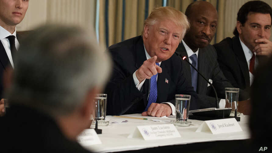 President Donald Trump speaks during a meeting with manufacturing executives