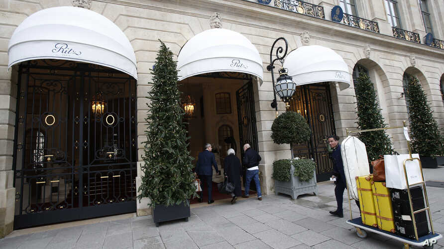 People enter the Ritz hotel in Paris, Jan. 11, 2018.