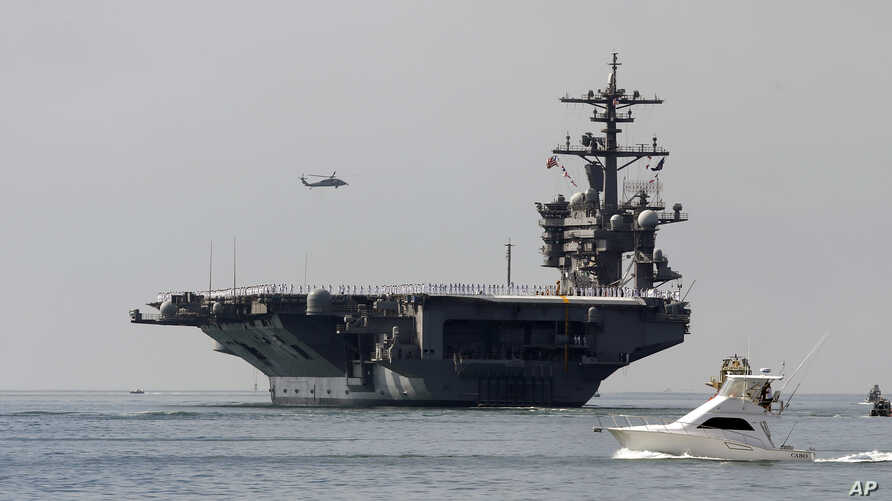 FILE - The USS Carl Vinson sails out of San Diego Harbor, Aug. 22, 2014.
