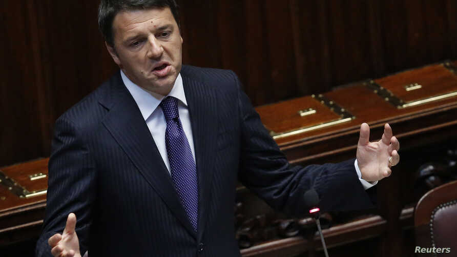 Italian Prime Minister Matteo Renzi gestures as he delivers his speech at the Italian Parliament in Rome June 24, 2014.